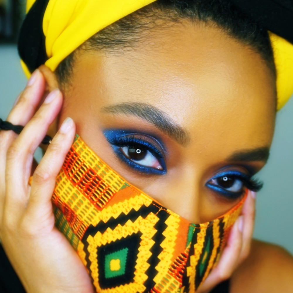 Orange African Print Face Mask with Blue Eye Makeup