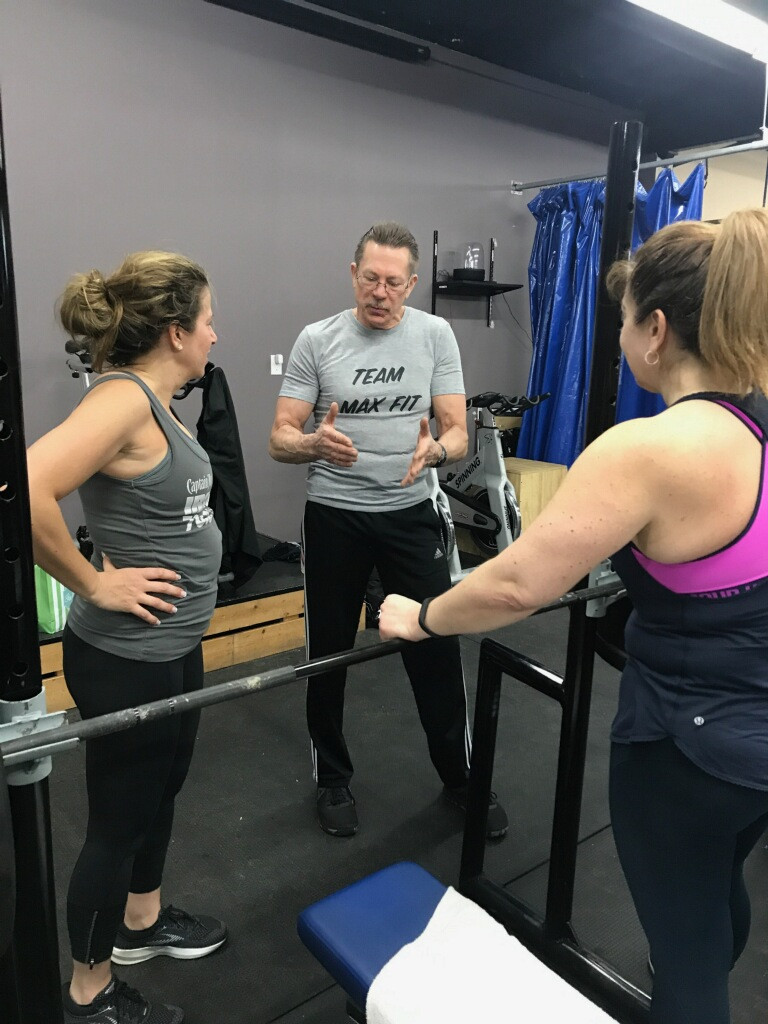 Max Fit Instructor Steve giving Lori and Lisa the lowdown.