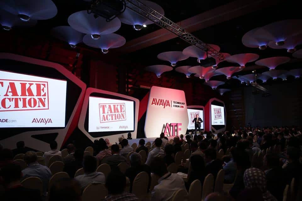 Tim-Wade-at-Avaya-event-big-stage-take-a