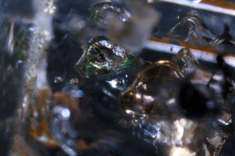 Petroleum, tar and a gas bubble... internally reflected in the waterclear quartz