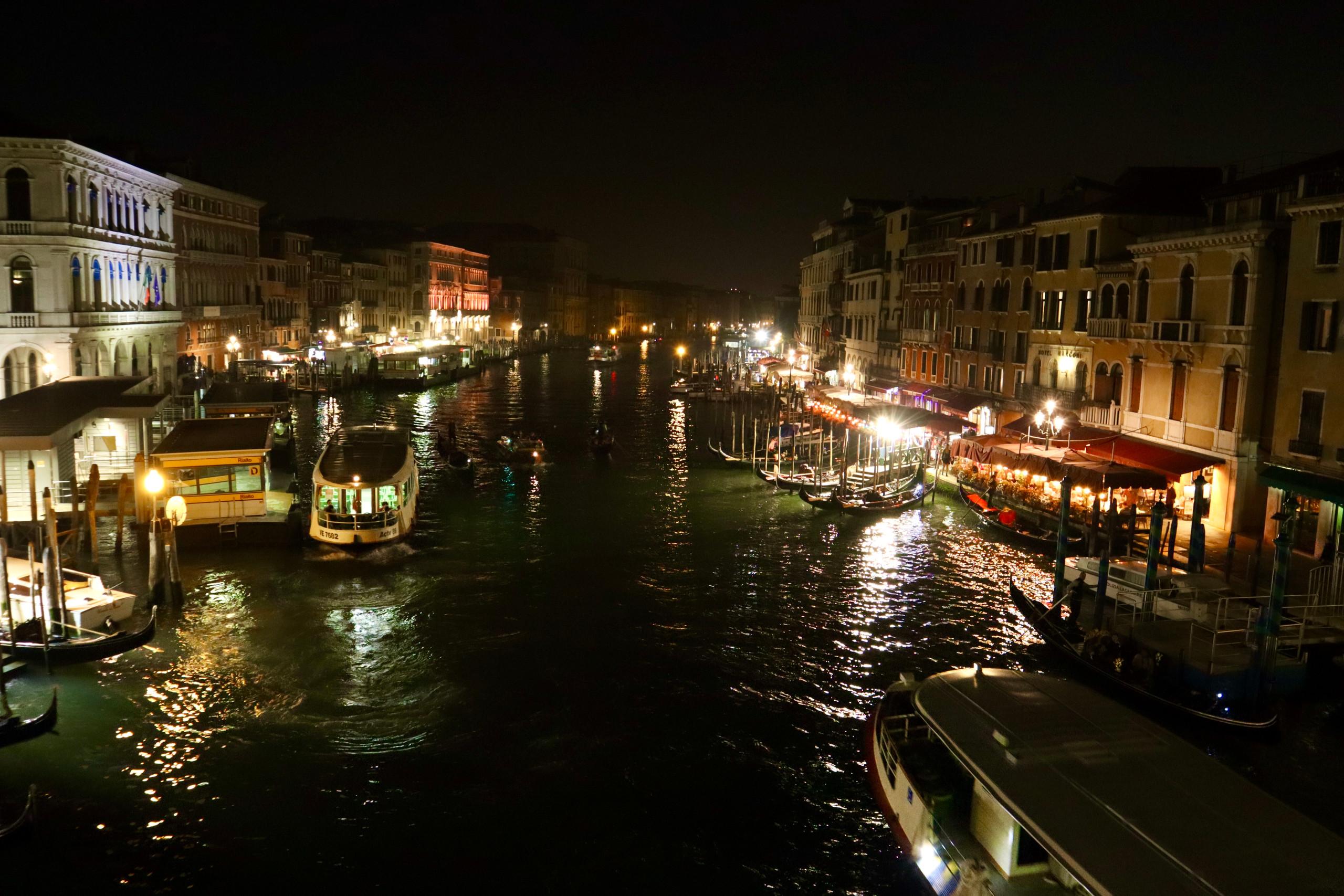 View of Venice overlooking Rialto Bridge (Ponte di Rialto) at nighttime by Biteinerary