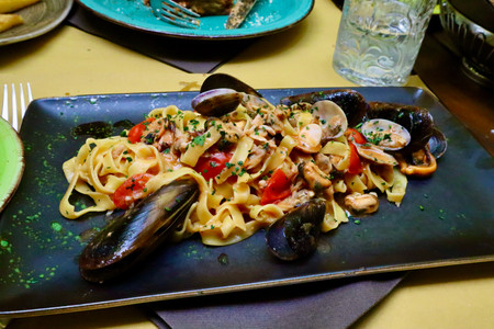 Delicious pasta, clam, and mussels dish served at Taverna Scalinetto in Venice, Italy by Biteinerary