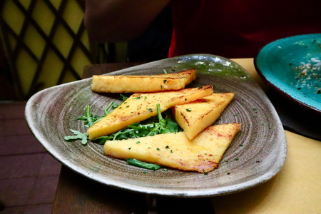 Polenta served at Taverna Scalinetto in Venice, Italy by Biteinerary