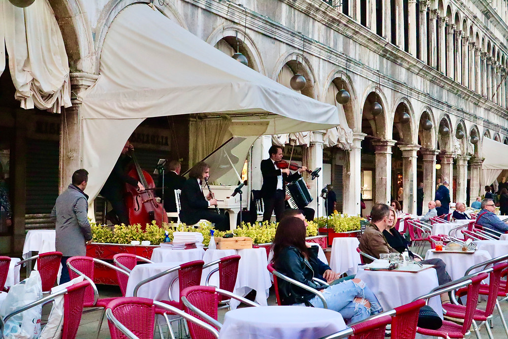 Live musicians at San Marco Square in Venice, Italy by Biteinerary