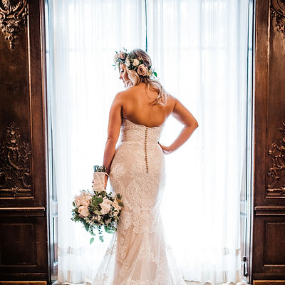 bride-at-window-with-bouquet.jpg