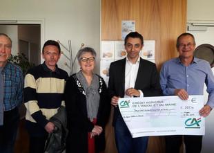 265,30 € de don à La Ligue contre le Cancer