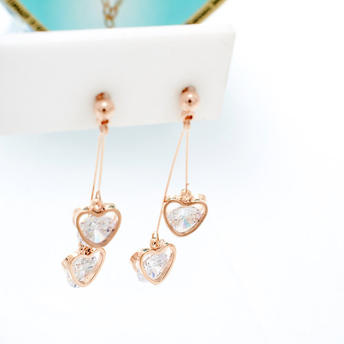 Fe7554 Κρεμαστά λεπτά σκουλαρίκια με καρδούλες σε rose gold απόχρωση!