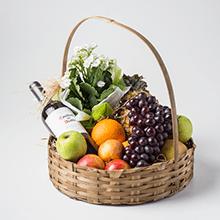 Cesta de frutas e vinho