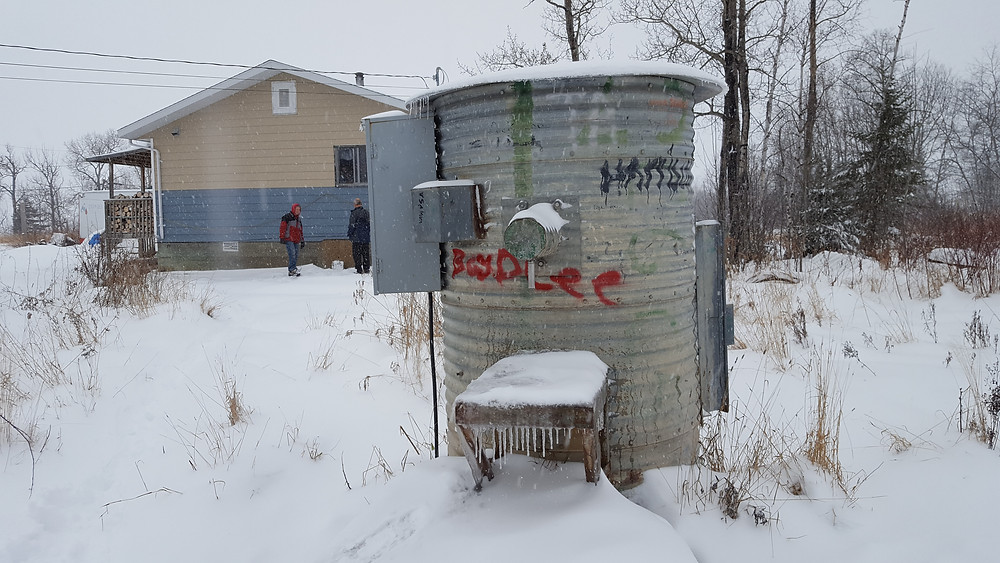A water holding tank where community members gather water.
