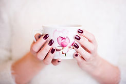 woman neils manicure with a cup of coffe