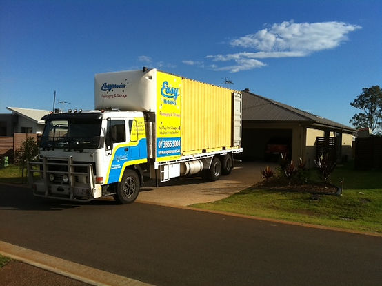 FURNITURE REMOVALIST IN NORTH BRISBANE. TRUCK BACKED IN DRIVEWAY