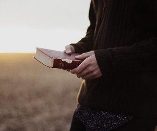 Man with bible sunset_edited_edited.jpg