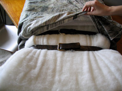 Belts as straps for fitting cover