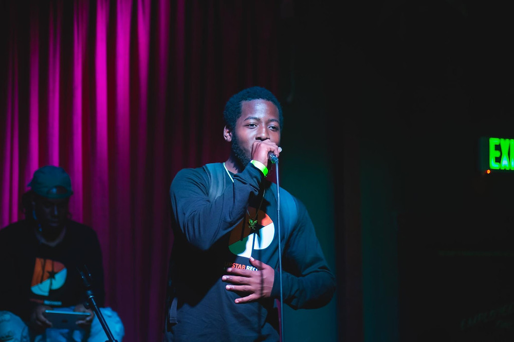 Young man sings on stage