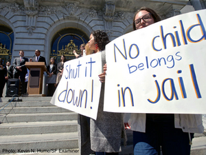 youth protesting with signs