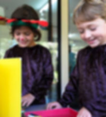 Two children making craft