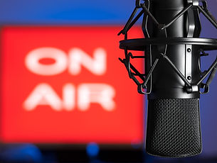 Microphone with blurred on  air sign in