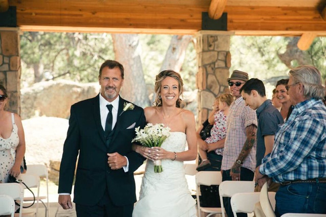 Kelsey and father walking down the aisle