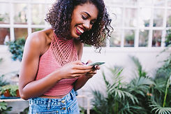 happy-woman-using-phone.jpg