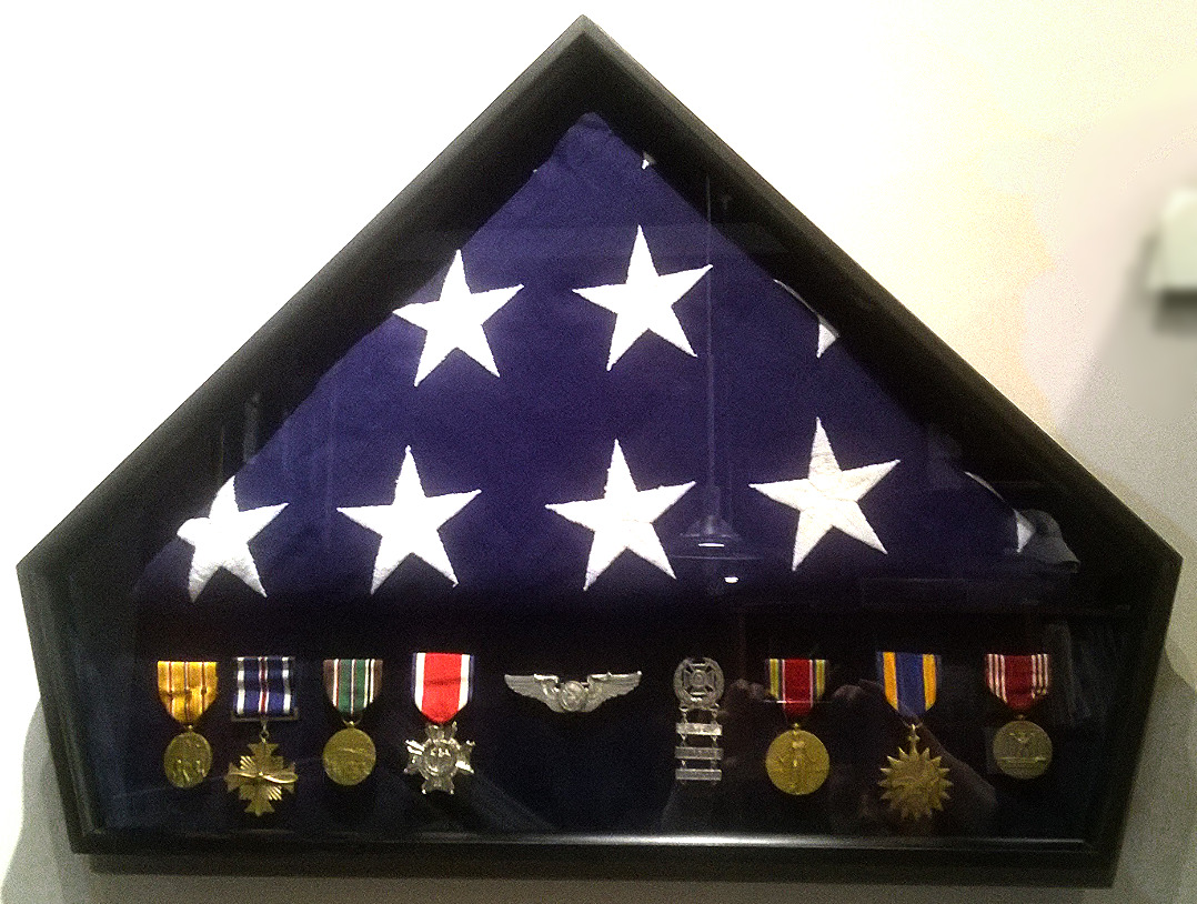 Framed Flag and military medals