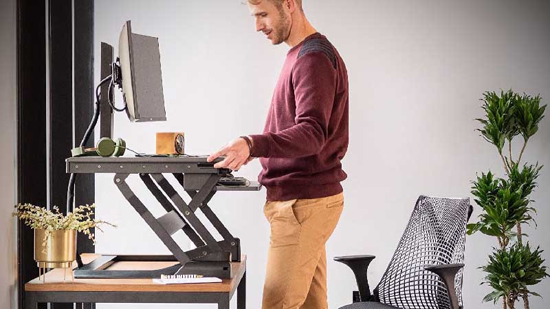 Trabajar en casa de pie don sistema de elevación de escritorio