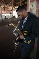 Stantawn Kendrick holding all saxophones