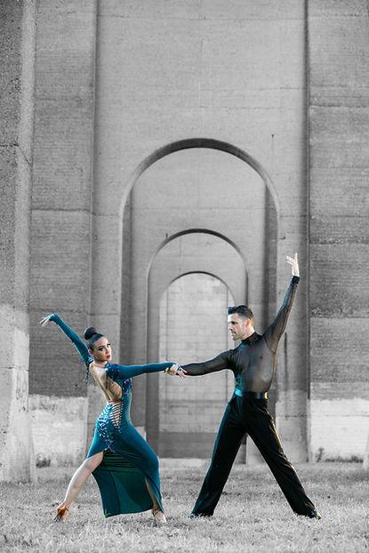 Professional dance couple posing under a bridge in New York