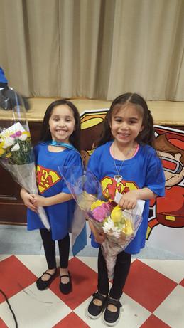 AEA Children holding flowers