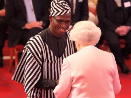 Philip Joel Cole receives Queens Young Leader 2015 Award in Madam Wokie