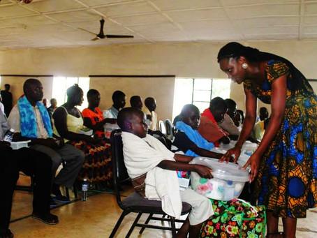 Maryann Kaikai presents care packages to survivors of the Ebola Crisis