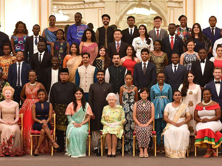 BRIMA MANSO BANGURA RECEIVES THE QUEEN'S YOUNG LEADERS AWARD WEARING MADAM WOKIE