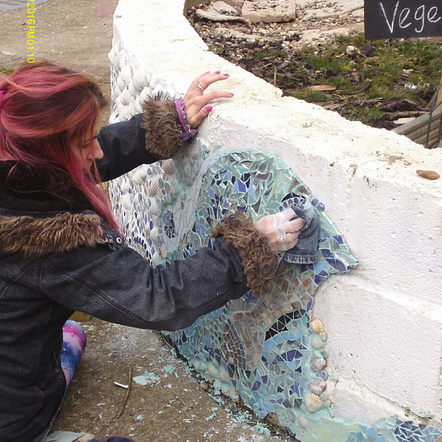 Jules adding last piece to Pocket Park mosaic 2016