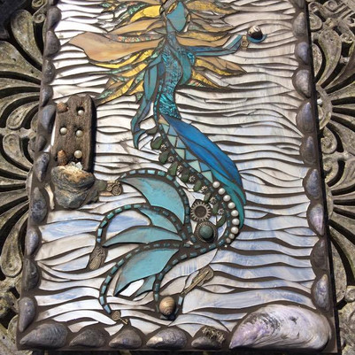 Mermaid about to grout .jpg