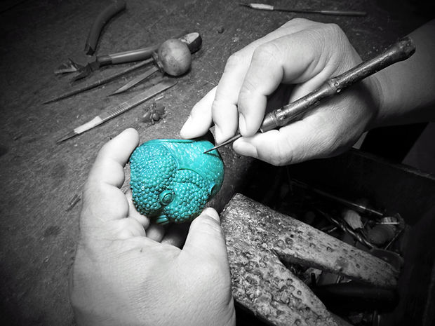 """Loyfar Pewter UK. One of the many early stages of creating a new product is to skilfully carve by hand, using only basic tools, a """"master"""" from wax."""