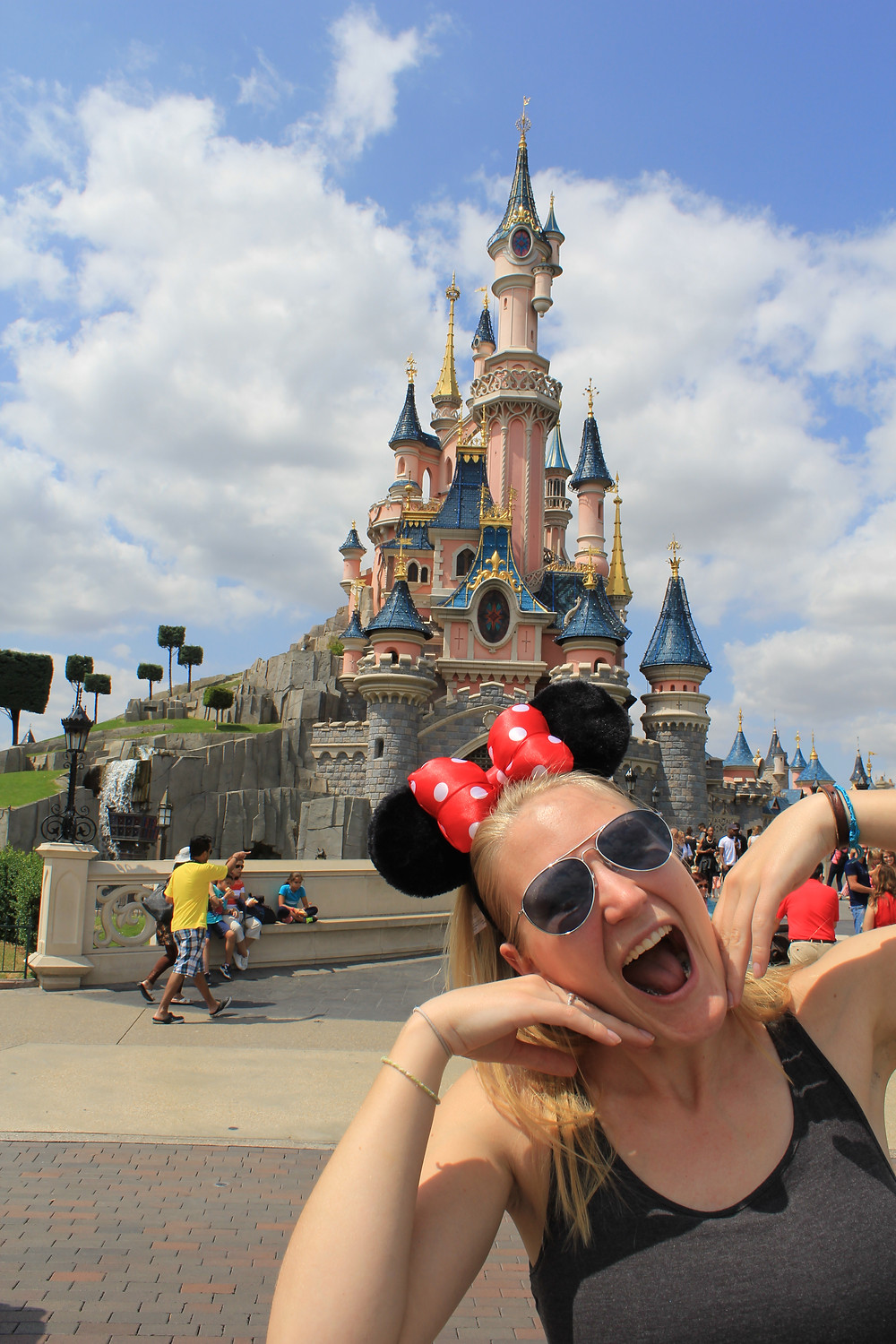Corrine wearing Minnie Mouse ears in Disneyland Paris