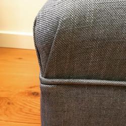 Bespoke footstool with corner pleat