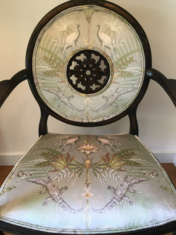Traditionally rebuilt and reupholstered feature chair