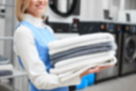 Worker Laundry girl holding fresh towels