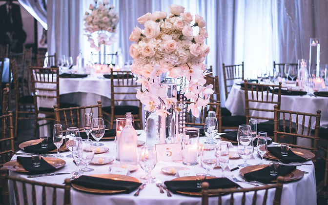 pink-and-white-roses-centerpiece-on-top-
