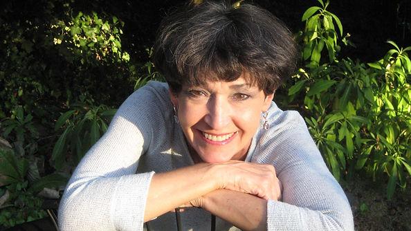 Photo of smiling practitioner, Nancy Pain Sherman
