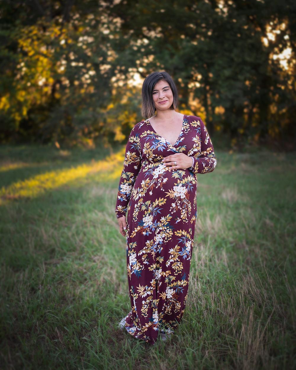 maternity session of woman standing in a field in Gretna, Nebraska