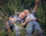 brothers-grass-field-portrait-gretna-nebraska-emdukat-photography