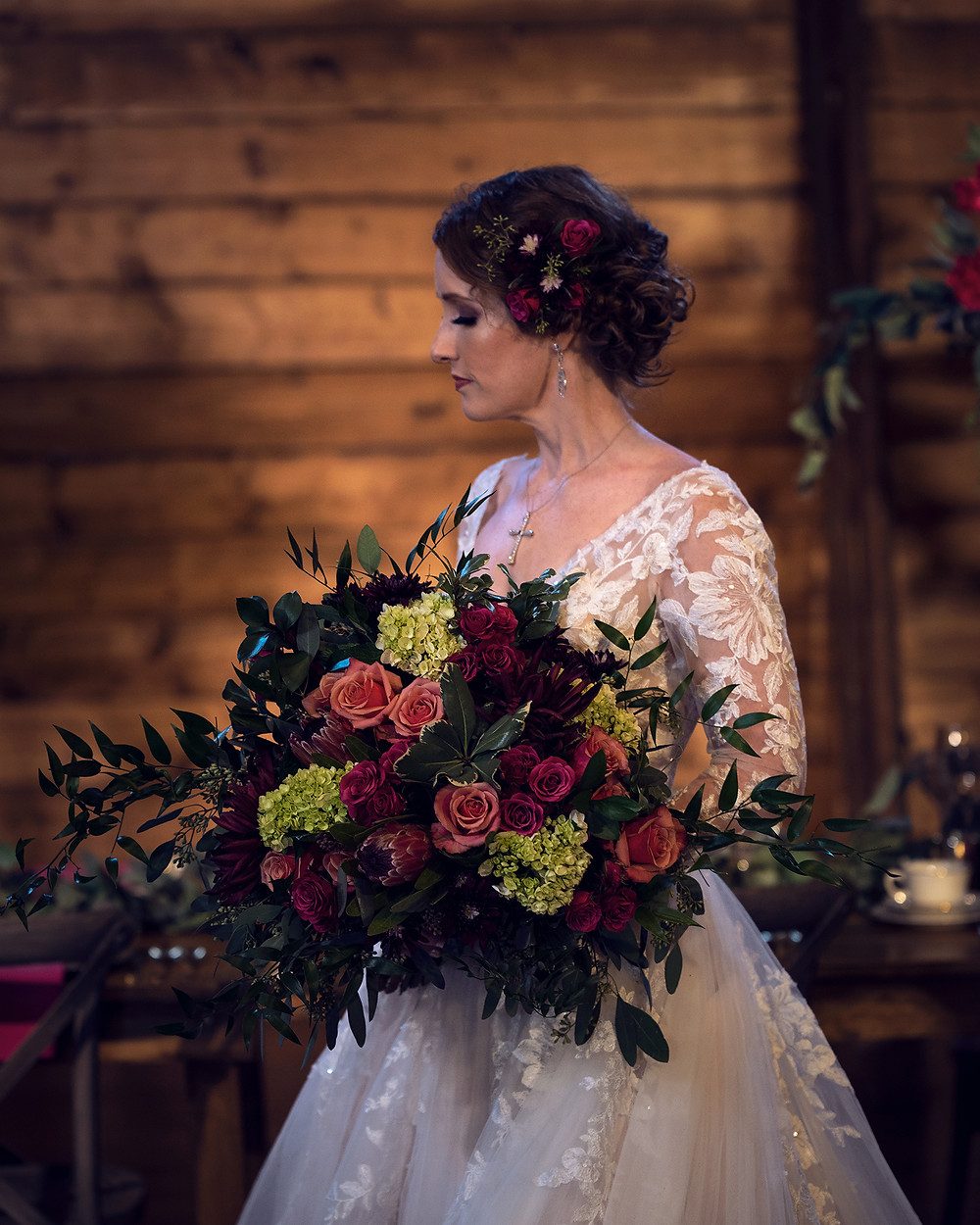bridal traditions gown with florals from Purple Orchid Flowers at Ackerhurst Dairy Farm in Bennington Nebraska