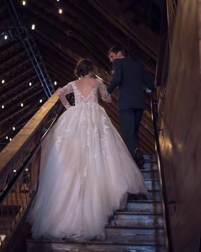 couple going upstairs to loft of Ackerhurst Dairy Farm in Bennington, Nebraska