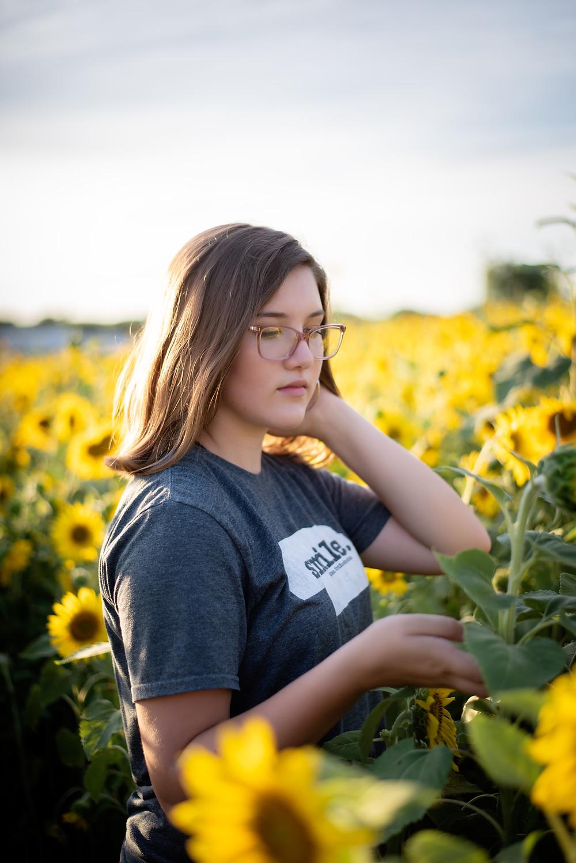 teen in the sunflowers at Nelson Produce in Valley, Nebraska