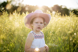 girl-grass-field-nebraska-emdukat-photography