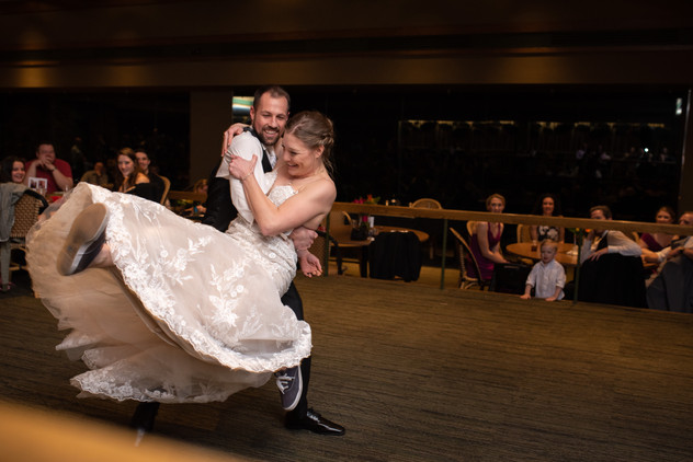 bride and groom playfully sparing during their wedding reception