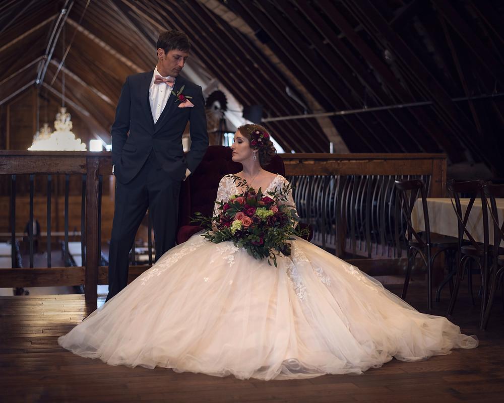model couple in loft at Ackerhurst Dairy Barn in Bennington, Nebraska