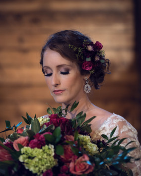 bride with Pretty in Patina jewelry with bouquet by Purple Orchid Flowers