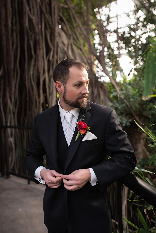 groom at wedding in Lied Jungle of Henry Doorly Zoo in Omaha, Nebraska